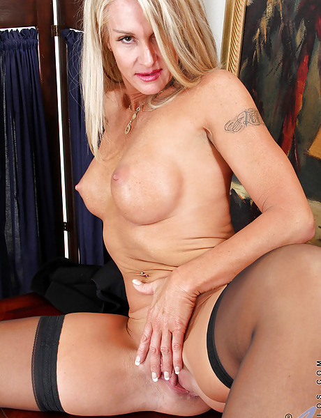 Alluring classy blonde lady takes her black lingerie off and fingers her vagina