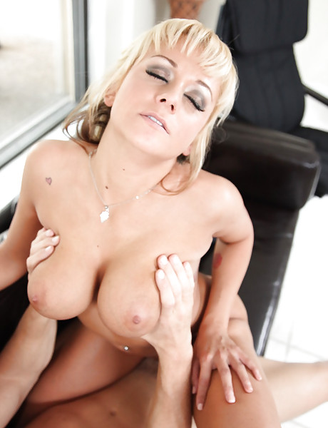 Smoking hot busty blonde bimbo screams loudly while she rides a big hard meat pole
