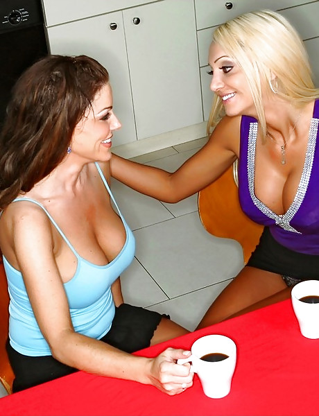 Hot busty blonde babe takes her clothes off and shares a big cock with her friend.