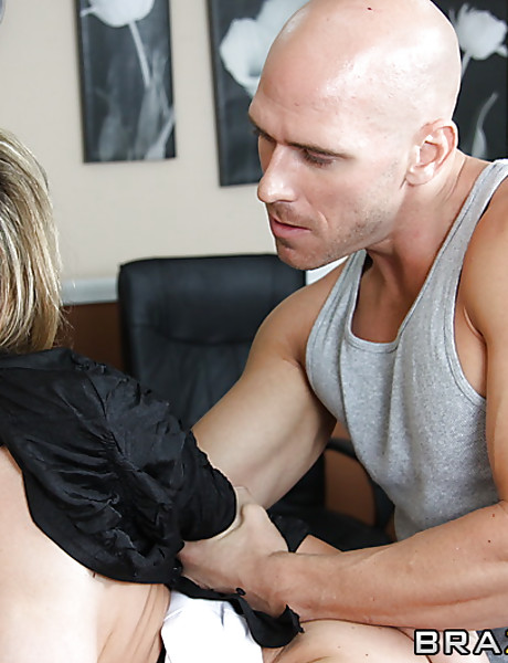 Foxy and classy blonde MILF strips her clothes at the office and fucks a coworker.