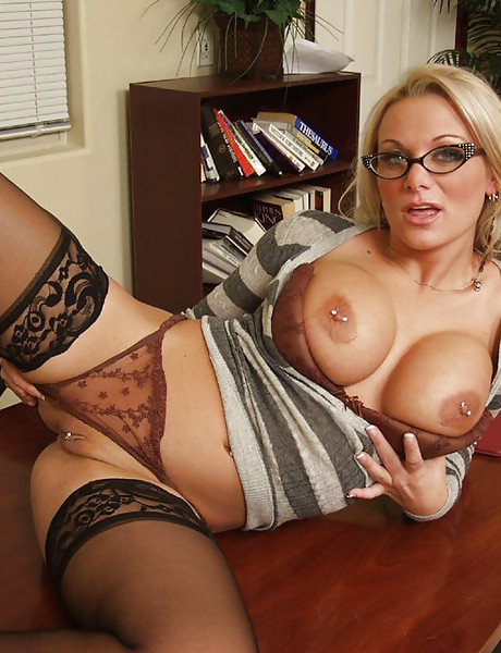 Foxy and busty blonde MILF takes her black lingerie off and fucks with two studs.