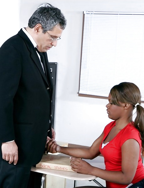 Lusty black bitch takes her clothes off in the classroom and gets fucked hard.