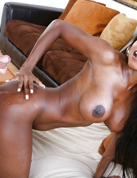 Busty black bitch takes her mini skirt off and rides a hard white boner for the cam.