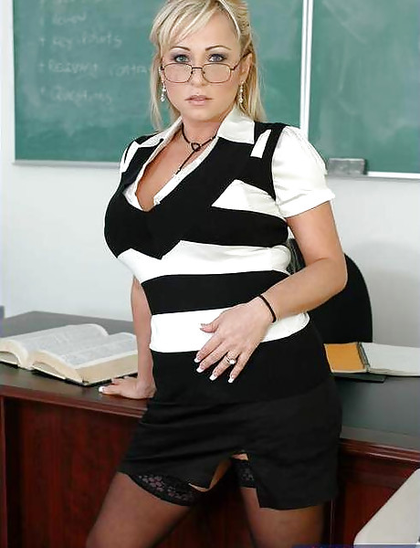 Classy MILF teacher strips her black lingerie in the classroom and fucks a student.