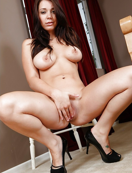 Busty brunette babe spreads her legs on the bed and gets her fanny banged hard.