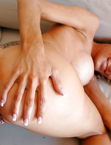 Big breasted MILF bitch takes her clothes off and rides a massive big dong.
