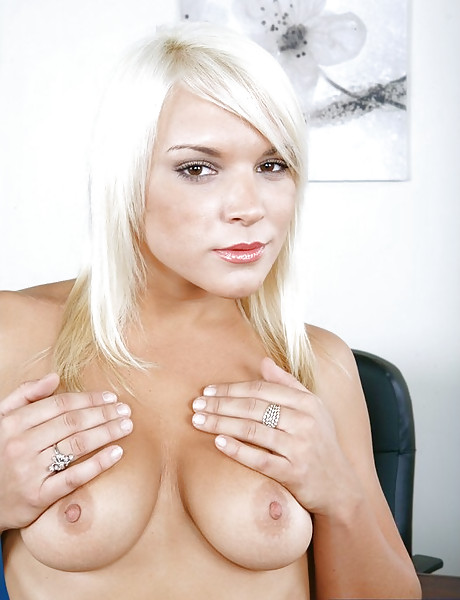 Big breasted classy blonde takes her black lingerie off and rides big hard shaft.