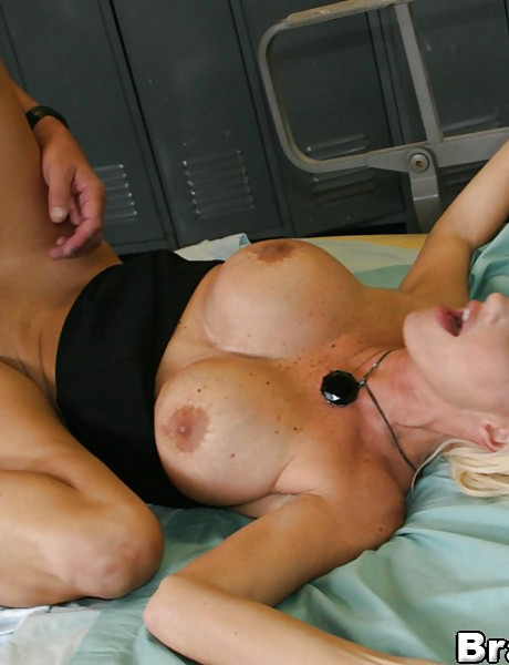 Alluring busty blonde babe takes her clothes in the locker room and fucks a jock.