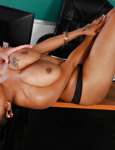 Busty ebony bitch takes her black thongs off and gets her muff pumped hard.