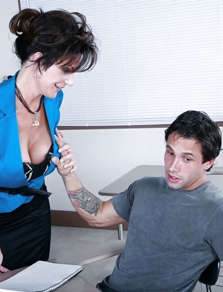 Classy mature teacher seduces her student and blows his big cock in stockings.