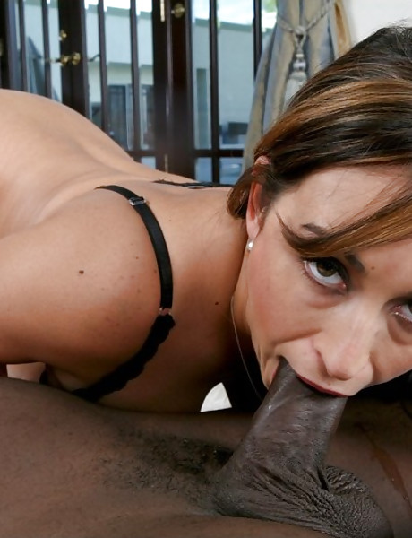 Hot brunette babe takes her black lingerie off and fucks with handsome black stud.