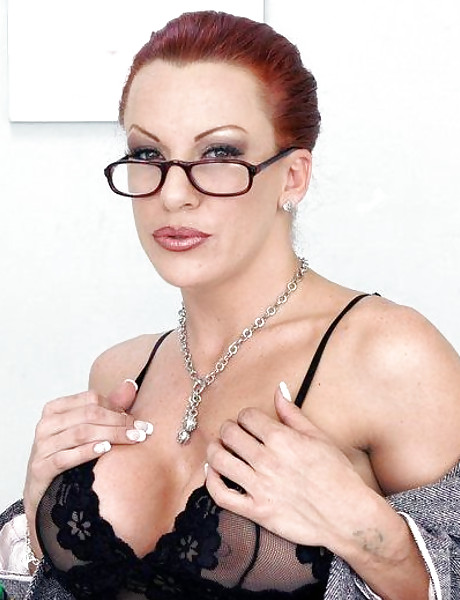 Busty and classy redhead babe takes her black lingerie off and fucks roughly.