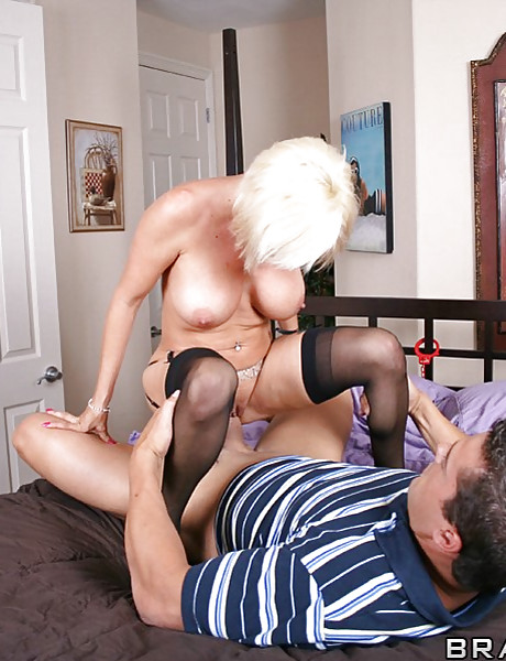 Hot big breasted MILF bitch moans hard as she fucks in sexy black stockings.