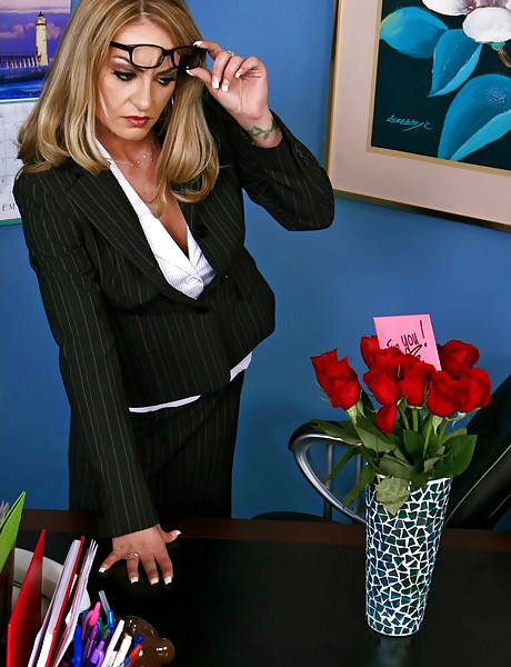 Busty classy office lady takes her clothes of and fucks with black hung dude.