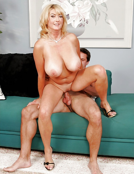 Busty blonde MILF bitch takes her clothes off and slurps on giant fat meat pole.