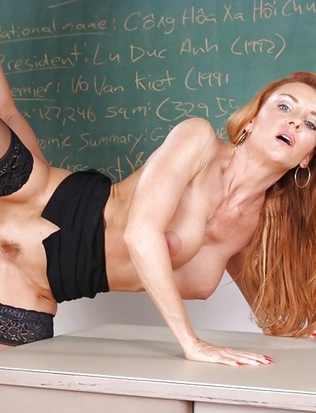 Classy redhead mature teacher seduces her student and fucks in black lingerie.