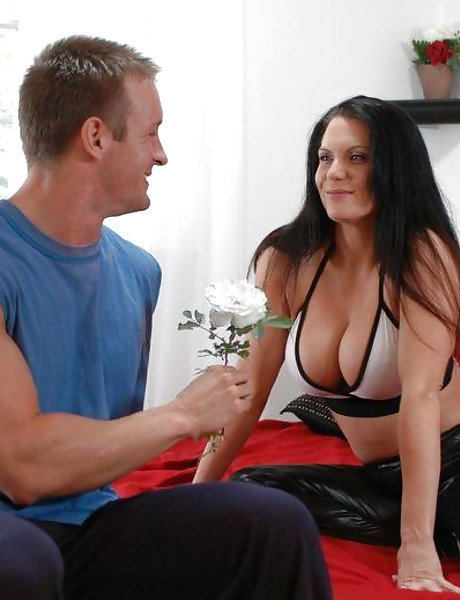 Smoking hot busty mature vixen takes her underwear off and fucks a younger stud.