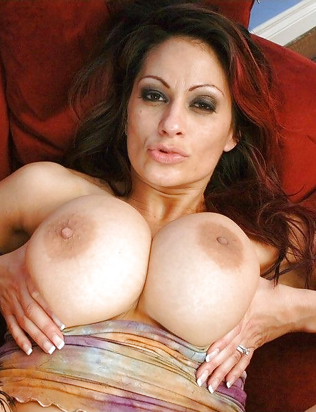 Hot busty brunette MILF removes her lingerie and gets roughly fucked on the bed.