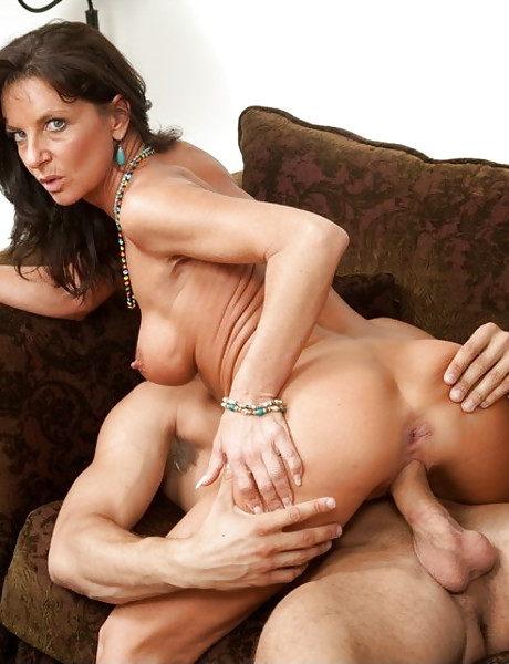 Hot busty MILF slut takes her clothes off and gets roughly banged by hard wood.