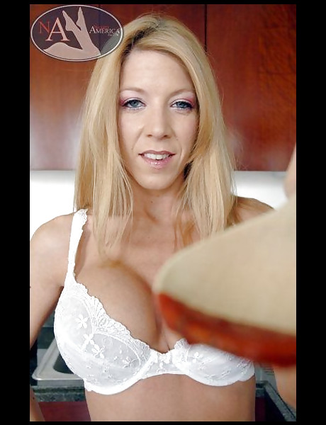 Attractive blonde babe takes her white lingerie off and gets fucked in the kitchen.