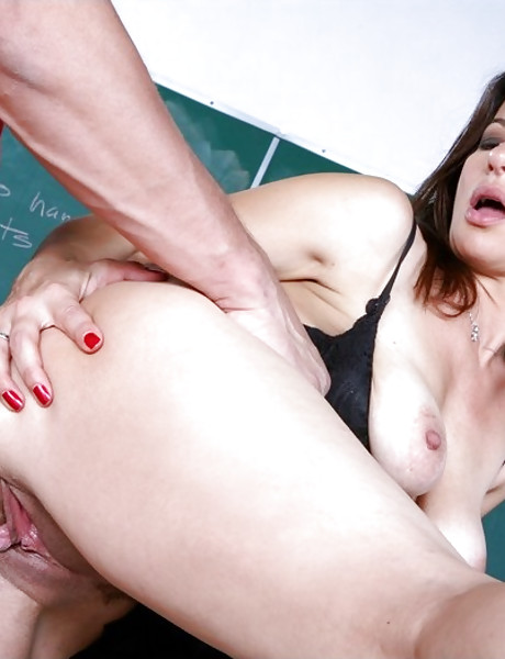 Fuckable briunette teacher seduces a student and rides his throbbing meat pole.