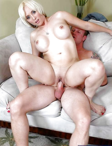 Horny mature wife takes her jeans off and gets fucked on the sofa in black thongs.