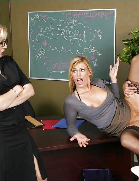 Classy blonde teacher and her hot blonde student share a big cock in stockings.