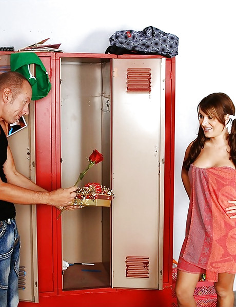Alluring busty chick strips in the locker room and fucks with a handsome jock.