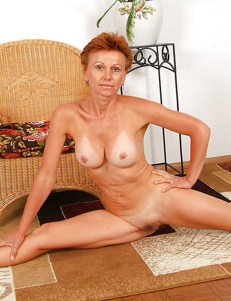 Horny mature redhead momma with nice boobs wearing red thong showing hairy cunt