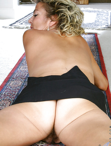 Horny blonde momma with tanned body lifting skirt and revealing her hairy wet twat