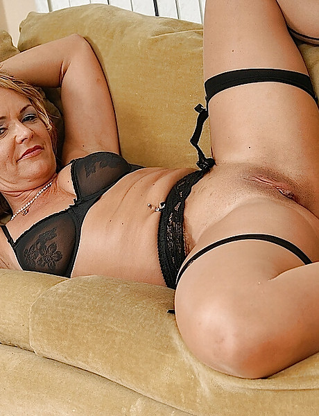 Horny milf with a perfect round tight ass in sexy black stockings stripping