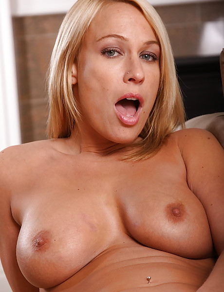 Gorgeous blonde milf with big saggy boobs and a sexy tanned curvy body teasing