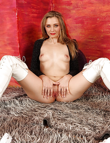 Horny babe with sexy white latex boots stripping and teasing with her pussy