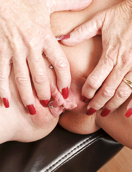 Hot blonde granny wearing sexy black lingerie and hot black naylons fingers her cunt