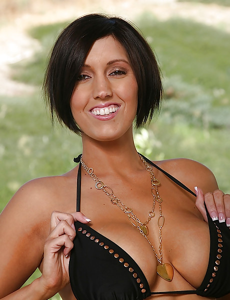 Gorgeous brunette with big massive boobs poses and teases with her soft pussy