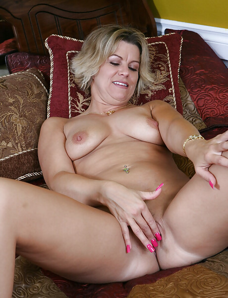Horny granny with a sweet shaved pussy stripping and fingering het wet cunt