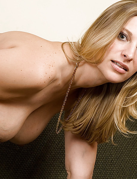 Sexy blond milf with big saggy boobs and a hot curvy body gets naked and teases