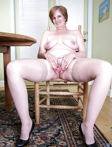 Slutty granny strips and shows her big round ass, saggy boobs and meaty pussy