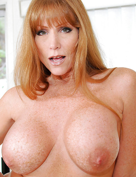 Gorgeous milf with sexy freckles all over her massive boobs fingers her shaved pussy