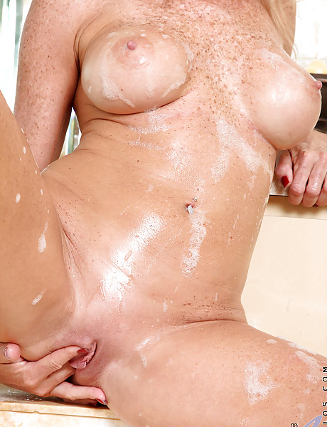Gorgeous milf with sexy freckles all over her tight body fingers her wet pussy