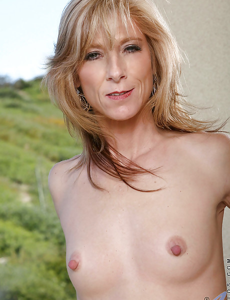 Sexy skinny blonde with small perky boobs strips and shows her body off in the open