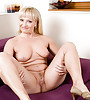 Sexy blonde milf with a hot curvy body and saggy boobs masturbating with a dildo