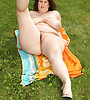 Gorgeous BBW mature babe sunbathing naked, stretching her hairy pussy and teasing