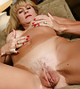 Horny mature blonde stripping and showing her meaty shaved pussy then fingering