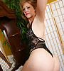 Cute and exy blond MILF gets off her white dress and dark undies and shows body