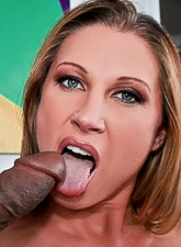 Big breasted blonde hottie kneels before her hung lover and slurps on huge black dong