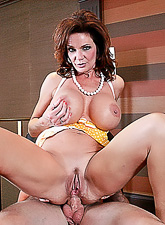 Classy brunette vixen takes her panties off and rides a huge stiff met pole