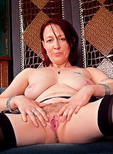 Classy brunette MILF lady takes her black lingerie off and shows her wet cunt