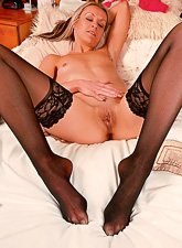 Classy MILF slut takes her lingerie on the bed and plays with her hungry wet muff