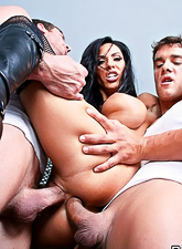 Slutty brunette bitch takes her latex dress and gets double fucked in boots